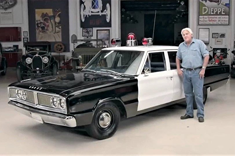Jay Leno in a 1966 Dodge Coronet Patrol Car
